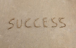Success. Written in the sand at the beach Stock Images