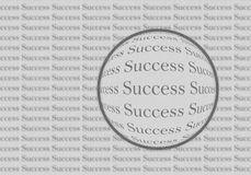 Success. Business success on a paper background with a magnifying glass on the word success Stock Photos