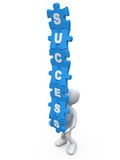 Success. Person balancing jigsaw puzzle pieces with the word success on them Stock Photos