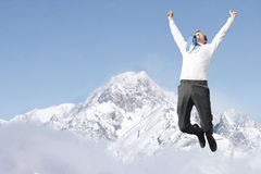 Success. A business man jumping with success Stock Photos