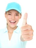 Success. Sporty happy woman showing thumbs up success hand sign cheerful wearing sporty cap. Fresh photo of Asian Caucasian female athlete isolated on white Royalty Free Stock Photo
