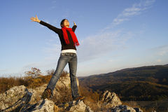 Success. Young girl stretching her arms on top of a mountain feeling success Stock Photos