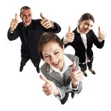SUCCESS!!!. Young attractive business people with thumbs up - success Stock Photo