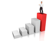 Success. Business man at the top of a rising bar chart - success or motivation concept Stock Image