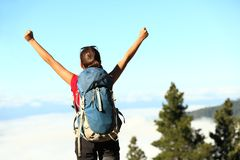 Success. Ful happy hiker cheering having reached summit and goal. Young woman hiking in mountain nature joyful Royalty Free Stock Photo
