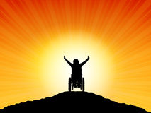 Success. Silhouette of a woman in a wheelchair with her arms raised in success Royalty Free Stock Photography