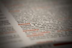Success. Macro shot of word in dictionary royalty free stock image