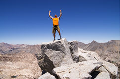 Success. A man celebrates his success on the summit of Mount Cotter Stock Image