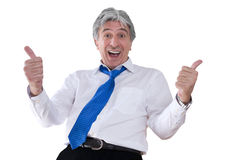 Success. Mature gray-haired smiling businessman with thumbs up Stock Image