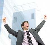 Success. Happy businessman celebrating success, outdoor Royalty Free Stock Photo