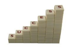 Success. Letter forming a rising chart, isolated on white royalty free stock photo