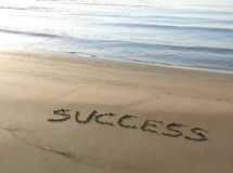 Success. Written on the sand of a beach Royalty Free Stock Image