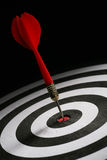 Success. Portrait shot of a Red dart on bull's eye of a dart board Royalty Free Stock Image