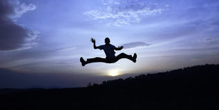 Success. Photo of a man jumping at sunset Royalty Free Stock Images
