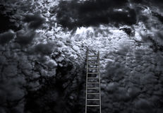 Success. Ladder into sky with light behind clouds Stock Photography