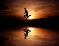 Success. Photo of a man jump in air moment Royalty Free Stock Photos