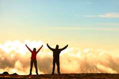 Success, achievement and accomplishment concept. With hiking people cheering and celebrating of joy with arms raised outstretched up in the sky on trekking hike royalty free stock photos