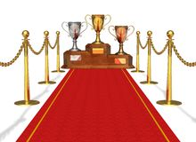 Success and achievement concept. Trophy cups on pedestal and red carpet isolated on white background Royalty Free Stock Photography