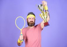 Success and achievement. Win tennis game. Tennis match winner. Achieved top. Tennis player win championship. Athlete. Hold tennis racket and golden goblet. Man royalty free stock photos