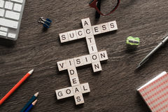 Success achieving business keywords collected of wooden cubes in crossword Royalty Free Stock Image