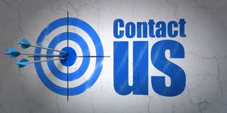 Advertising concept: target and Contact Us on wall background. Success advertising concept: arrows hitting the center of target, Blue Contact Us on wall Stock Photos