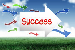 Success against blue sky over green field. The word success and arrow against blue sky over green field Royalty Free Stock Photo