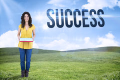 Success against blue sky over green field Stock Image