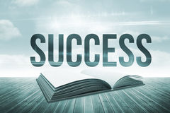 Success against open book against sky Royalty Free Stock Image