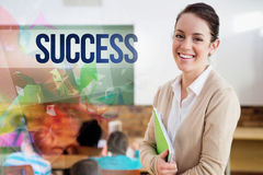 Success against pretty teacher smiling at camera at back of classroom. The word success against pretty teacher smiling at camera at back of classroom Stock Photos