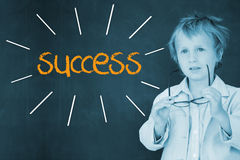 Success against schoolboy and blackboard Stock Photos