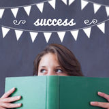 Success against student holding book Royalty Free Stock Image