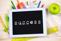 Success against students table with school supplies Stock Photo
