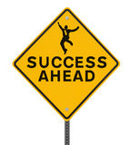 "Success Ahead. ""Success Ahead"" road sign with a silhouette of a man jumping (isolated on white with clipping path Stock Image"