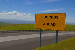 `Success Ahead` Yellow Road Sign Stock Images