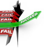 Success Arrow Jumps Chasm Failure Falls Into Hole. Several red arrow with the word Fail plunge into a chasm while one successful green arrow with the word Royalty Free Stock Photography