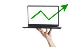 Success arrow sign on laptop Stock Photography