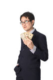 Success Asian businessman holding dollar money, isolated Royalty Free Stock Image