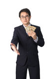 Success Asian businessman holding dollar money and shaking hands Stock Photos