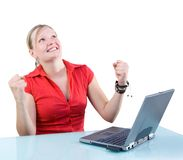Success! Attractive Businesswoman with Laptop. Young attractive businesswoman triumphant with laptop at her desk Isolated white background Stock Image