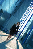 Success avenue. Business woman walking confident thru a corporate complex in the beautifull dusk light Royalty Free Stock Photography