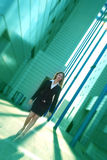 Success avenue. Business woman walking confident thru a corporate complex in the beautifull dusk light Stock Photography