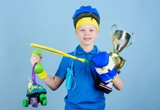 Success and award. Success in sport. Proud of achieved success. Succeed in everything. Athlete successful boy sport. Equipment jump rope boxing glove tennis stock photography