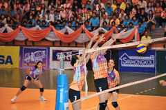 Success blocking ball in volleyball players chaleng Stock Photo