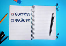 Success box checked on notebook Stock Photography