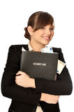 Success in business. Business woman taking holding the document case with money in the hands as a symbol of wealth Stock Image