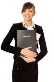 Success in business. Business woman holding the document case with money in the hands as a symbol of wealth Royalty Free Stock Photography