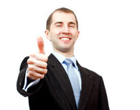 Success in business. Seccessful businessman with thumb a lift Royalty Free Stock Photography