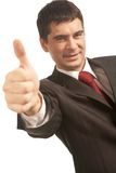 Success in business. Image of happy businessman showing thumb up Royalty Free Stock Images