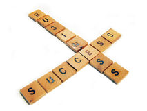 Success in business. Letters with business and success words crossed. Letters pieces in wood Stock Images
