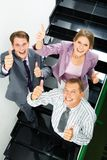 Success in business. Portrait of businesspeople showing sign of okay Stock Image